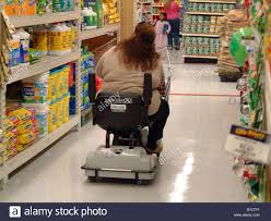 wal mart cart stock photos wal mart cart stock images alamy fat obese w on an electric shopping cart wal mart usa walmart wal mart obesity