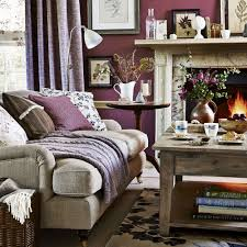 Warm up your living room in the colder months with plum tones. Combine  shades of claret and dusky rose to make the space toasty and snug.