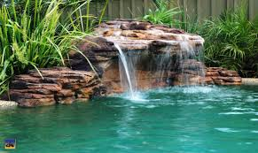 swimming pool rock waterfalls and fountains add value to your home swimming pool rock waterfalls