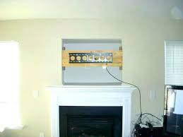mounting tv on stone fireplace mount above fireplace mounting above fireplace hiding wires how to install