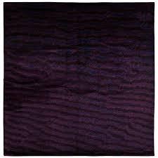 deep purple area rug with fish skin print for