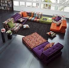 minimalist interior with floor black and sitting area with colorful floor cushions and carpet black