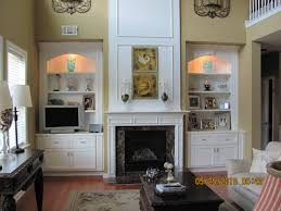 gray painted living room interior wall with brown marble fireplace f