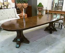 mocha finish racetrack end double pedestal extending table