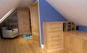 A bedroom that slopes on both sides with a wide center. A pair of double