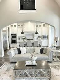 all white kitchen with greys and a grey and silver living room with an open