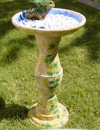 this bird bath stand a little taller than the usual two pot design with four pots stacked atop each other to create the base this bath is a bit taller and