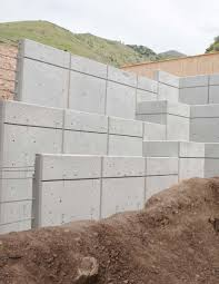 retaining walls complicate the construction of concrete walls significantly with the footing and tie requirements