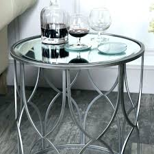 silver side table and glass round metal
