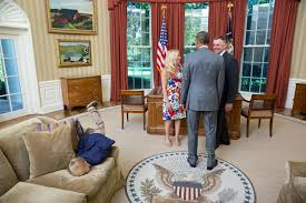 oval office white house. A Young Boy Face-plants Onto The Sofa In Oval Office As President White House