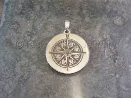 hand engraved sterling silver compass rose pendant