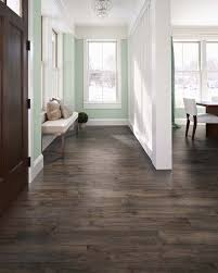 homes always look better with contrast we love this mint green wall with the dark pergo max premier smoked chestnut floor