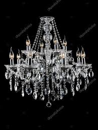 contemporary glass chandelier isolated over black background photo by nikitabuida