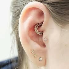 The Curated Ear Personally Stylizing Multiple Ear Piercings