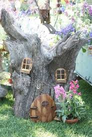 fairy garden, tree trunk house