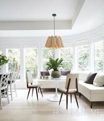 a large white banquet creates a cal yet sophisticated vibe in this kitchen s dining