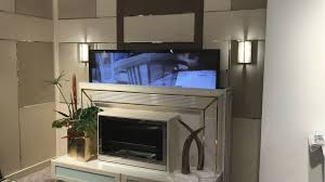 TV Lift Cabinets That Disguise Your Electronics As Elegant Furniture