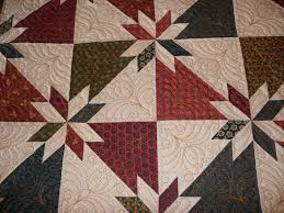 Acorn Ridge Quilting: Cheryl's Hunter Star Quilt & I custom quilted it with a variety of feather patterns. Adamdwight.com