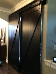 barn doors over sliding gl doors dark brown double barn door over entryway