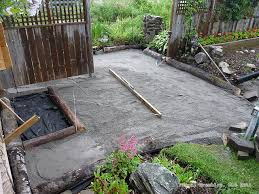 edging paved area with log border