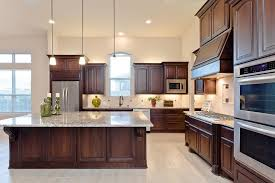 open design kitchen with blanco taupe granite counters