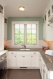 cambria countertops colors with traditional laundry room also built in cabinets gray floor green walls penny tile undercabinet lighting white cabinets
