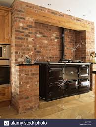 Exposed Brick Kitchen Black Double Aga Oven In Exposed Brick Wall In Country Kitchen