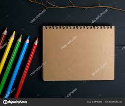 Notebook With Brown Pages And Multicolored Wooden Pencils Stock
