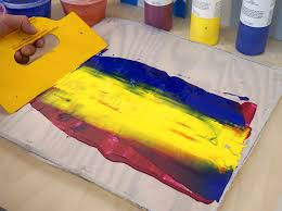 casting an acrylic skin by spreading fluid acrylics on a plastic sheet