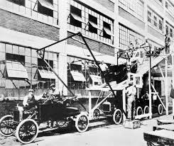 Image result for the first moving assembly line is introduced by the Ford Motor Company.