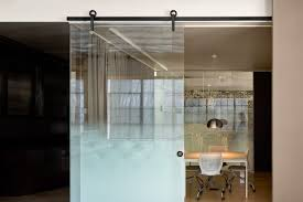 Krownlab's BALDUR black stainless steel glass mount sliding barn door  hardware was used at the Skylab's