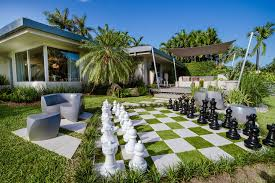 Modern Yard with Kettler Giant Chess Pieces, Heller Frank Gehry Easy Lounge  Chair, exterior