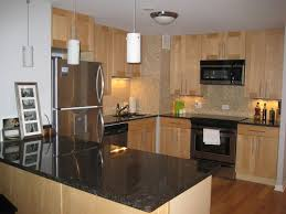 Black Granite Countertops With Tile Backsplash Gorgeous Natural Maple Cabinets Black Granite Countertop Subway Tile
