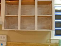 Painting Knotty Pine Cabinets The Remodeled Life Diy Painting Knotty Pine Cabinets