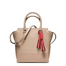 Lyst Coach Legacy Perforated Mini Tanner Bag In Natural