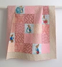 Hey, I found this really awesome Etsy listing at https://www.etsy ... & Baby Girl Quilt featuring Peter Rabbit in Shades of Pink Cream Aqua Blue by  KimsQuiltingStudio on Adamdwight.com