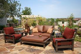 red colored furniture design applied in outdoor living space of pottery barn outdoor furniture with green