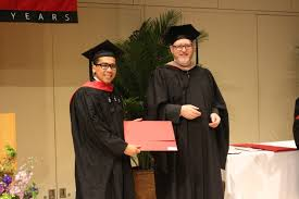 Michael Ubac receiving his Harvard diploma and Director     s Prize for Best Thesis from the Dean of Harvard Continuing Education and Extension School      Inquirer Global Nation