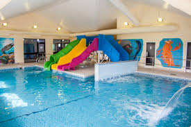 indoor pool with waterslide. Crows Nest Caravan Park: Heated Indoor Swimming Pool With Waterslide