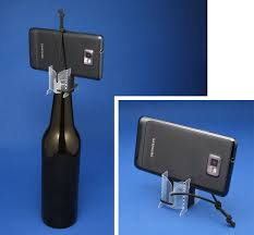 how to make a small tripod stand for smartphones can be placed on top of bottles or stand for it self design by benny johansson