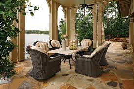 stone patio table. Euro Height Outdoor Wicker Chairs And Stone Patio Table Traditional-patio O