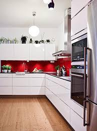 modern black white.  black red splashback white cabinets silver appliances and wooden floor  very  similar to my colour scheme on modern black white e