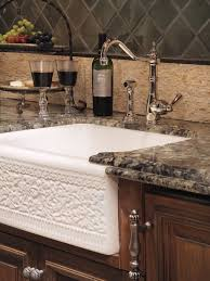 tuscan kitchen photo in phoenix with granite countertops a farmhouse sink dark wood cabinets