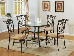 5 pc jessica metal and gl dining table set with fabric upholstered chairs this set features fabric upholstered seats and a gl top table with