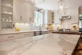modern off white kitchen. Off-white Kitchen With Honed Calacatta Gold Marble Countertop. #Offwhitekitchen #OffwhitekitchenCountertop # Modern Off White