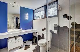 exquisite bathroom with a splash of blue and hexagonal tiles design josée lemire