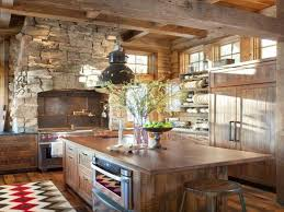 stone fireplace with tribal patterned rug and hardwood floor for enticing country kitchen designs layouts