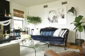 vintage blue velvet sofa and glass waterfall table via primitive and proper