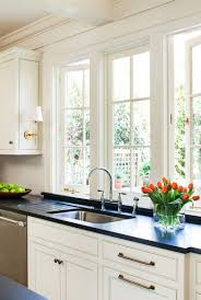 Sconces On Cabinets Above Kitchen Sink Window Interiors Kitchens