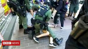 Hong Kong protests: Police tackle 12-<b>year</b>-<b>old</b> girl to the ground ...